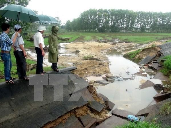 越南政府为中部地区灾民克服台风和洪水后果提供资助 hinh anh 1