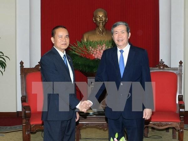 越共中央书记处常务书记丁世兄会见柬埔寨人民党中央办公厅主任 hinh anh 1