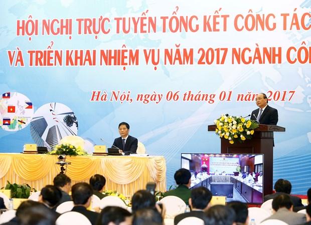 政府总理阮春福出席2017年工商部工作任务部署视频会议 hinh anh 1