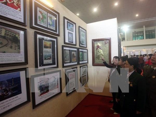 """""""黄沙、长沙归属越南:历史证据和法律依据""""资料图片展在清化省举行 hinh anh 1"""
