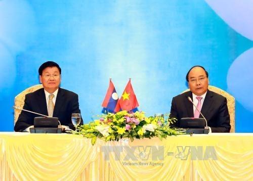 老挝媒体:越老政府间联合委员会第39次会议助于进一步深化两国关系 hinh anh 1