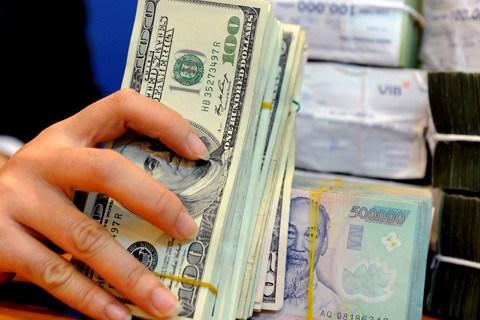 10日越盾兑美元中心汇率持续上升 商业银行美元价格回落 hinh anh 1