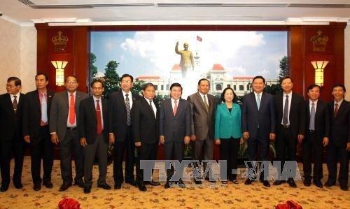 越南胡志明市与老挝占巴塞省加强合作 hinh anh 1