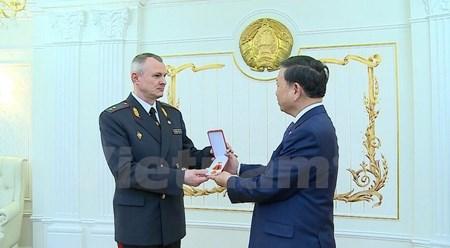 越南公安部部长苏林出席白俄罗斯警察力量成立100周年纪念典礼 hinh anh 1