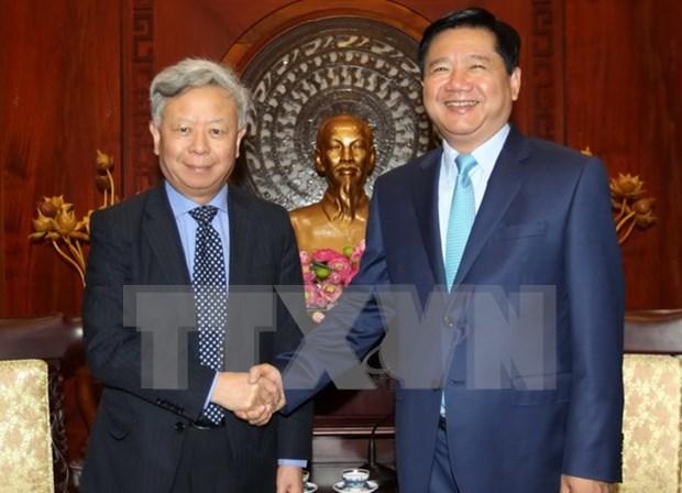 胡志明市委书记丁罗升会见亚洲基础设施投资银行行长 hinh anh 1