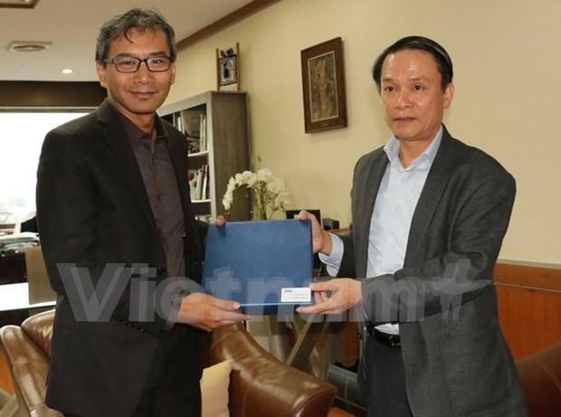 越南通讯社与印尼安塔拉通讯社承诺强化合作 hinh anh 1