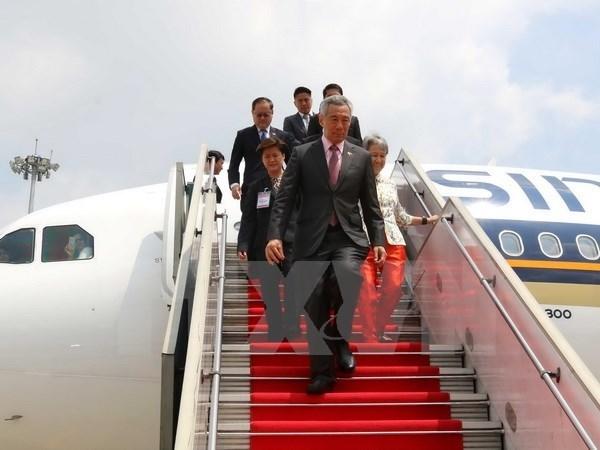 新加坡总理李显龙会见越南岘港市委书记阮春英 hinh anh 1