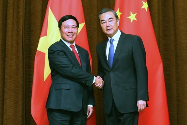 越南政府副总理兼外交部长范平明同中国外交部长王毅举行会谈 hinh anh 1