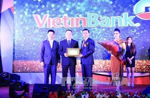 越南-老挝经贸投资合作前景乐观 hinh anh 1