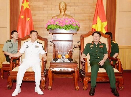 越南人民军总政治局主任会见中国人民解放军海军政治委员 hinh anh 1