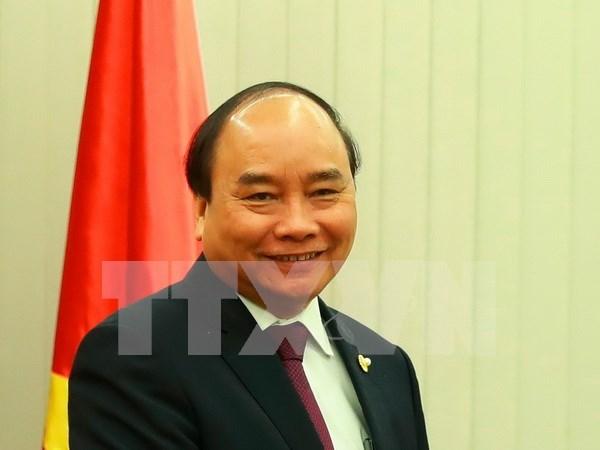 越南政府总理阮春福即将出席2017年世界经济论坛东盟峰会 hinh anh 1