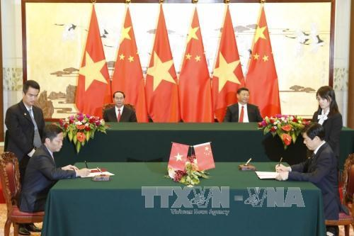 越南国家主席陈大光与中共中央总书记、中国国家主席习近平举行会谈 hinh anh 2