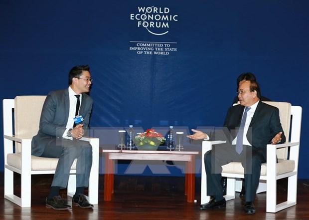 政府总理阮春福出席2017年世界经济论坛东盟峰会的相关活动报道 hinh anh 1