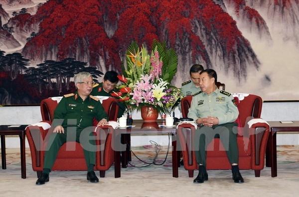 越南国防部副部长阮志咏会见中共中央军事委员会副主席范长龙上将 hinh anh 1