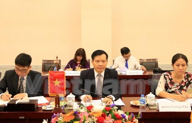 越老建交50周年:越共中央办公厅与老挝人革党中央办公厅加强合作 hinh anh 1
