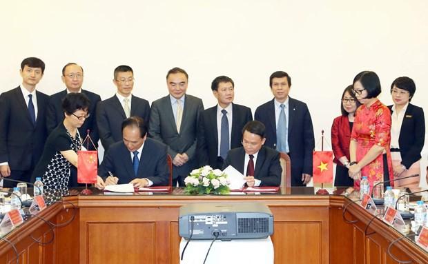 越通社与新华社签署新合作协议 hinh anh 2