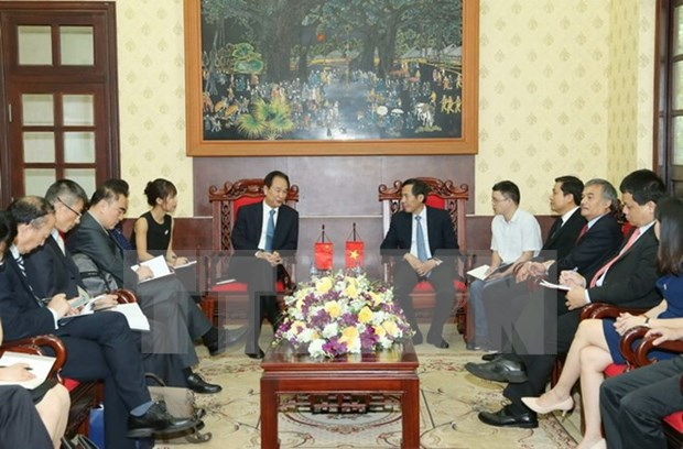 新华社社长蔡名照访问越南《人民报》社 hinh anh 1