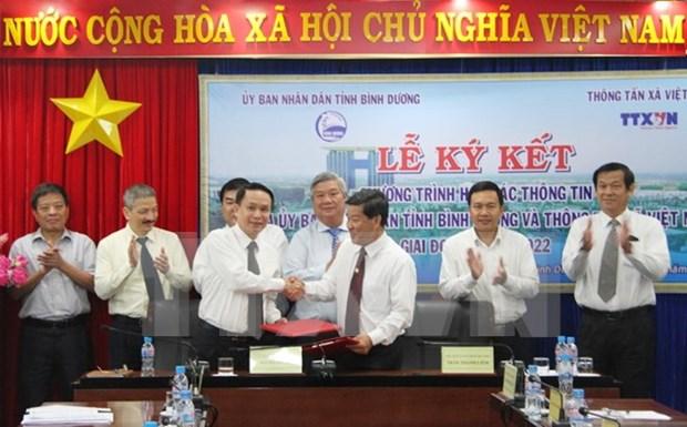 越南通讯社与平阳省签署信息合作协议 hinh anh 1