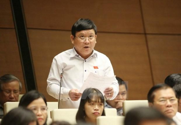 越南第十四届国会第三次会议:不把处置不良贷款的一切责任都算到银行头上 hinh anh 1