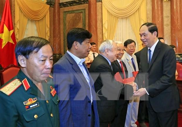国家主席陈大光会见援柬越南老志愿军代表团 hinh anh 1