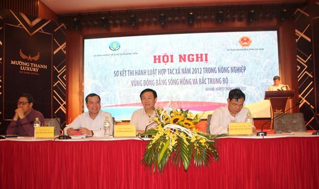 政府副总理王庭惠主持越南北部地区落实2012年《合作社法》小结会议 hinh anh 1