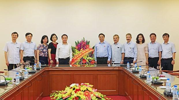 越南革命新闻日:范明正向越通社全体工作人员致以节日祝贺 hinh anh 1