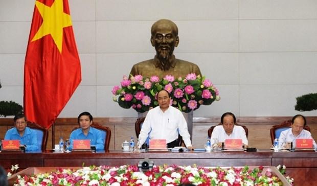 阮春福:政府一直关注确保劳动者生活和工作条件 hinh anh 1