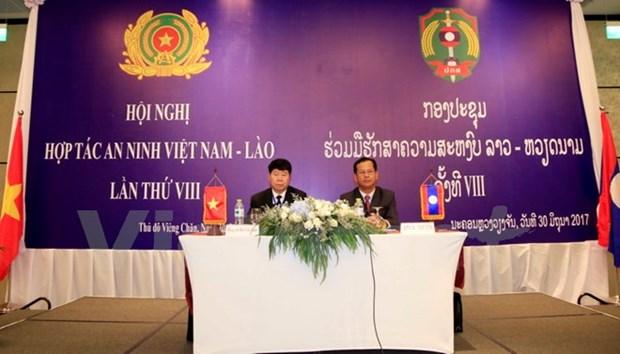 第八次越老安全合作会议在老挝举行 hinh anh 1