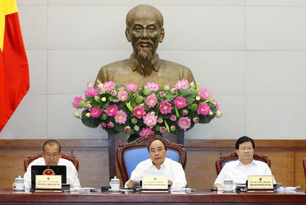 越南政府总理阮春福主持召开政府6月份例行会议 重点讨论法制建设问题 hinh anh 1