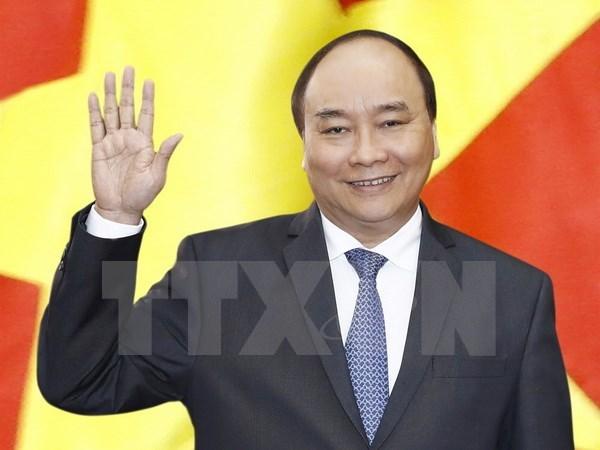 越南政府总理阮春福启程对德国进行访问并出席二十国集团峰会 hinh anh 1