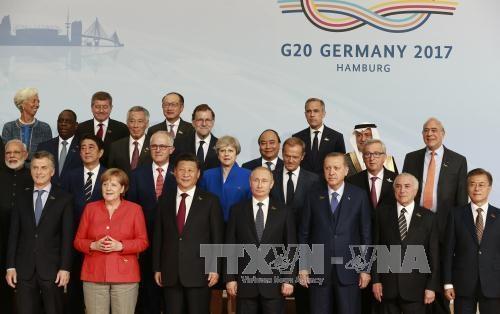 德国政客和媒体高度评价越南在二十国集团领导人峰会的作用 hinh anh 1