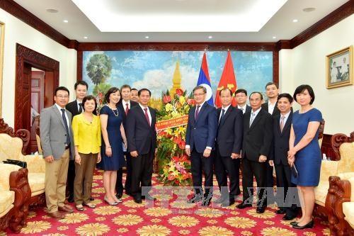 越南外交部与老挝驻越大使馆举行活动 庆祝越老友好团结年 hinh anh 1