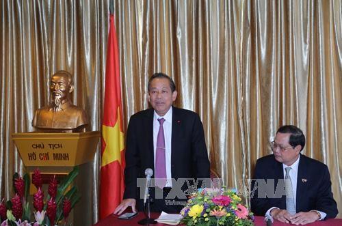 张和平副总理高度评价旅新越南人的作用 hinh anh 1