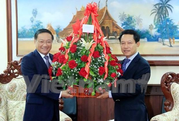 越老建交55周年:越南党、国家、政府和国会领导人向老挝领导致贺电 hinh anh 1