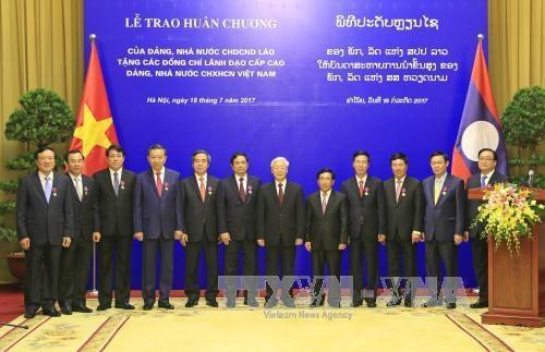 越南国家主席陈大光:愿为维护和继续培育越老特殊团结关系作出努力 hinh anh 1