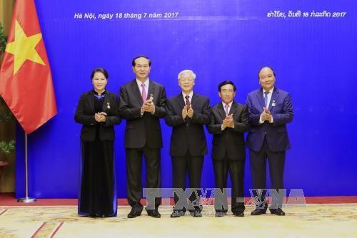 越南国家主席陈大光:愿为维护和继续培育越老特殊团结关系作出努力 hinh anh 2