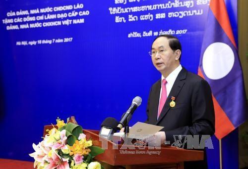 越南国家主席陈大光:愿为维护和继续培育越老特殊团结关系作出努力 hinh anh 3