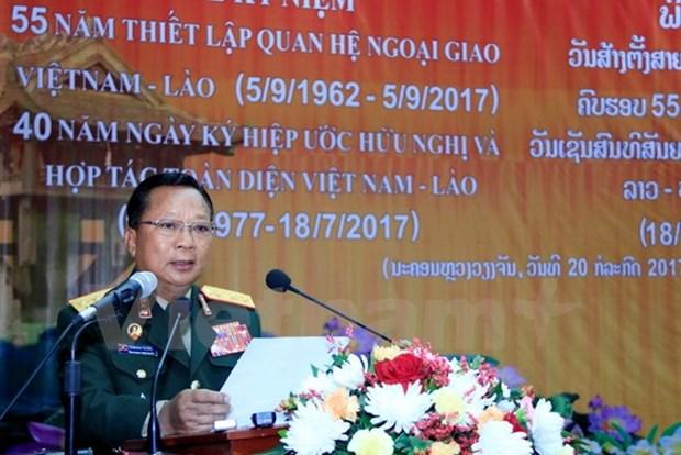 越老建交55周年:老挝国防部举行越老建交55周年纪念集会 hinh anh 1
