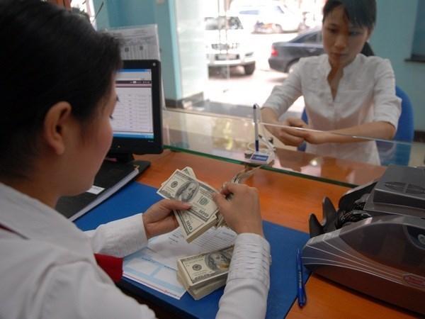 21日越盾兑美元中心汇率较昨日下降1越盾 hinh anh 1