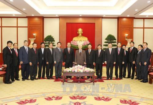 越共中央总书记会见老挝人民革命党代表团 hinh anh 1
