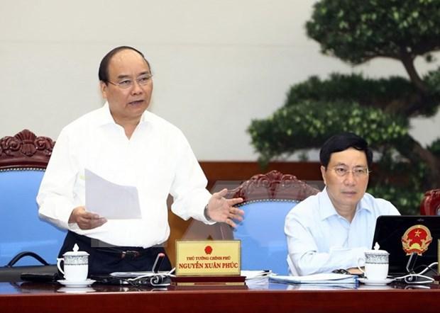 政府总理阮春福:正确评估每个行业和领域现状 力争完成2017年各目标 hinh anh 1
