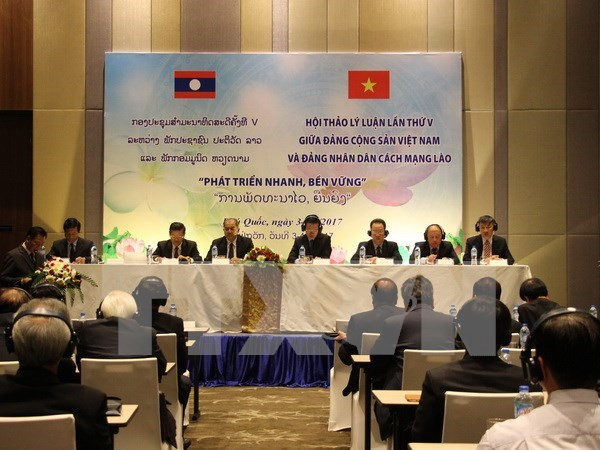 越南共产党和老挝人民革命党第五次理论研讨会拉下帷幕 hinh anh 1