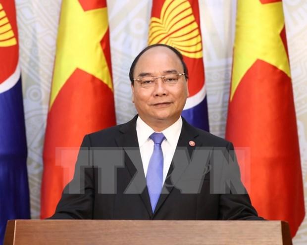 阮春福总理:越南愿与各国一道努力建设团结、自强的东盟共同体 hinh anh 1