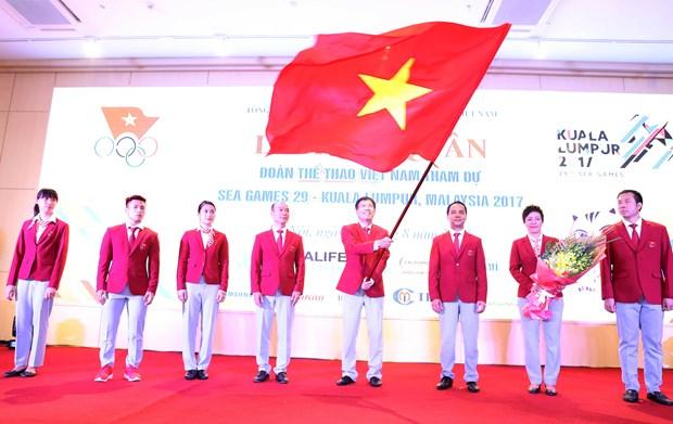 第29届东南亚运动会越南体育代表团出征仪式在河内隆重举行 hinh anh 1