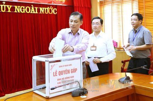 越南各中央机关纷纷捐款帮助西北地区洪水受灾群众 hinh anh 1