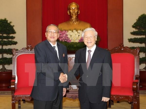越共中央总书记阮富仲会见柬埔寨人民党中央监察委员会代表团 hinh anh 1