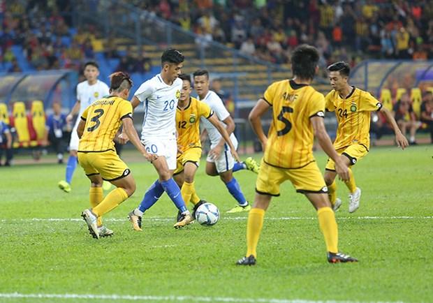 第29届东南亚运动会男足比赛:东道主马来西亚队以2比1击败文莱队 hinh anh 1