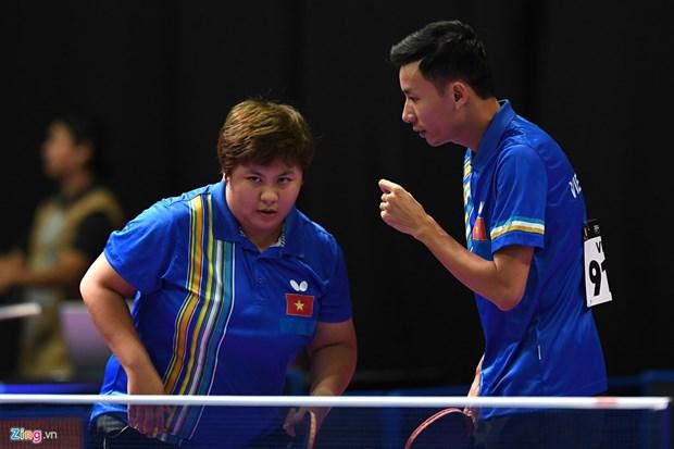 第29届东南亚运动会:越南乒乓球选手丁光灵和梅黄美妆夺得铜牌 hinh anh 1