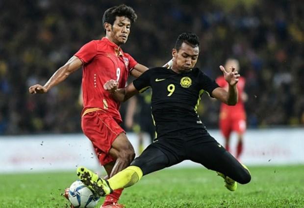 第29届东南亚运动会男足比赛:马来西亚男足队提前晋级半决赛 hinh anh 1