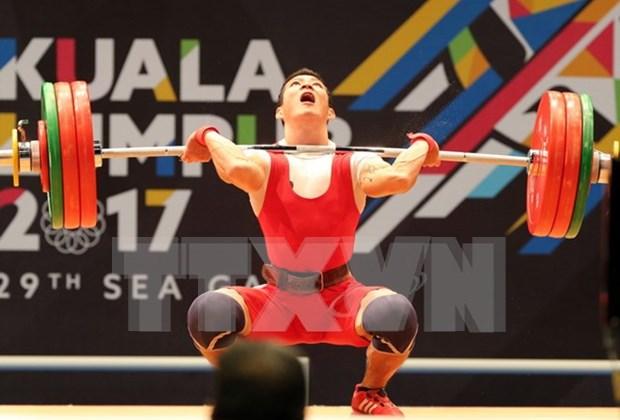 第29届东南亚运动会:28日越南举重运动员夺得两金 hinh anh 1